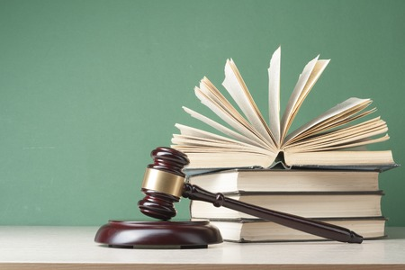 prosecutor: Book with wooden judges gavel on table Stock Photo