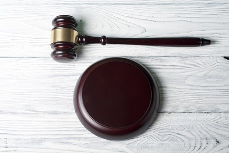 enforcement: wooden judges gavel on table in a courtroom or enforcement office