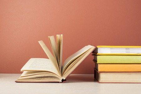 Open book, hardback books on wooden table. Education background. Back to school. Copy space for text Stock Photo