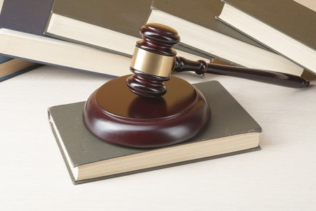 enforcement: Law concept - Book with wooden judges gavel on table in a courtroom or enforcement office