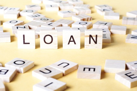 loans: Wooden Blocks with the text  Loans. Wood ABc.