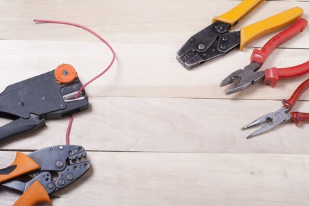 dielectric: Set of electrical tool on wooden background. Accessories for engineering work, energy concept