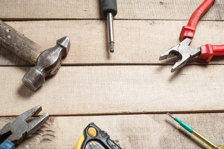 wirecutters: Construction tools on wooden background. Copy space for text. Set of assorted work tools at wood table . Top view. Stock Photo
