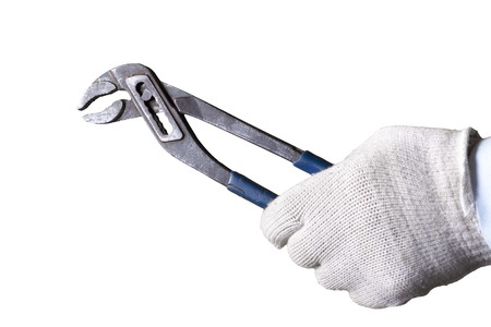 Plumbers Hand holding monkey wrench spanner isolated on white background.