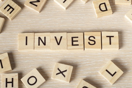 nonprofit: invest word written on wood block. Wooseb Abc