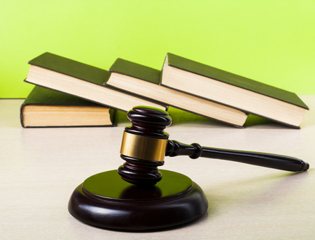 Law concept - Books with wooden judge gavel on the table in a courtroom or enforcement office.Copy space for text. Stock Photo