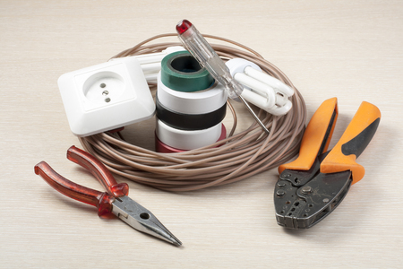 Set of electrical tools on wooden background. Energy concept. Stock Photo