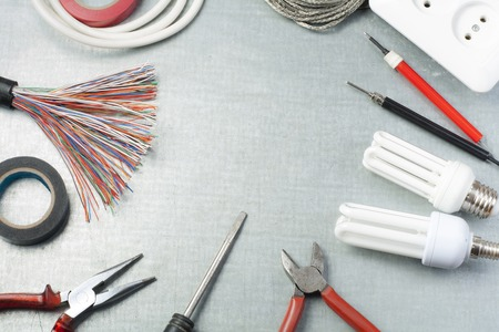 Set of electrical tools on metallic background. Energy concept.Copy space for text.
