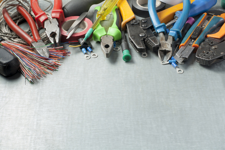 Set of electrical tools on metallic background. Accessories for engineering work, energy concept.Copy space for text.