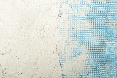 Plastic grid for plastered wall. Free copy space.