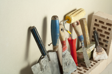 Construction tools in a row and bricks. Building and renovation concept.