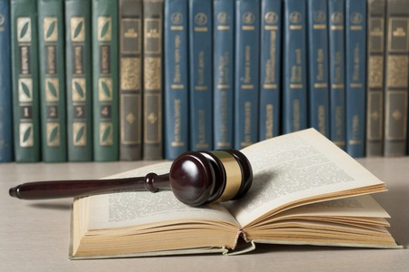 Law concept. Books with wooden judges gavel on table in a courtroom or enforcement office. Stock Photo