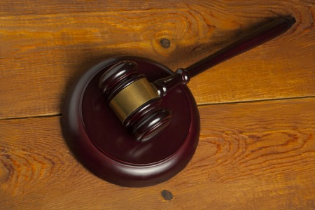 Law concept. Wooden judge gavel on table in a courtroom or enforcement office.