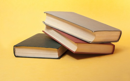 Old books on yellow background. Education concept. Back to school. Copy space for text.