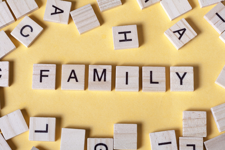 Word FAMILY on a wooden letters. Wood abc Imagens