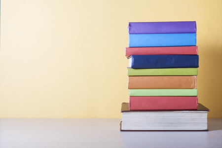 Stack of colorful books. Education background. Back to school. Copy space for text.