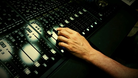 the mixing: Sound engineer mixing on a mixing desk