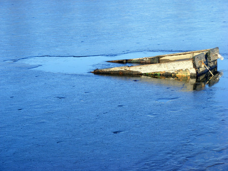 thin ice: Boat under the thin ice