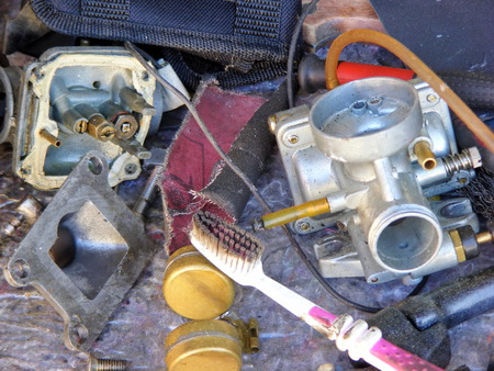 carburettor: Motorcycle parts and repair work on the table