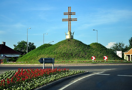 Roundabout in szerencs city with hills and crown on the road