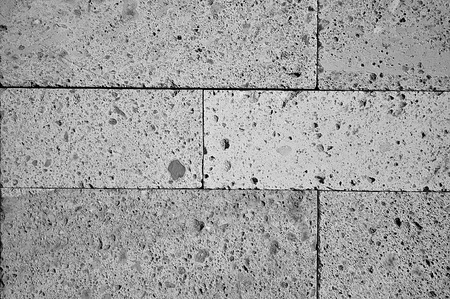 brick building: Abstract black and white brick building wall background texture