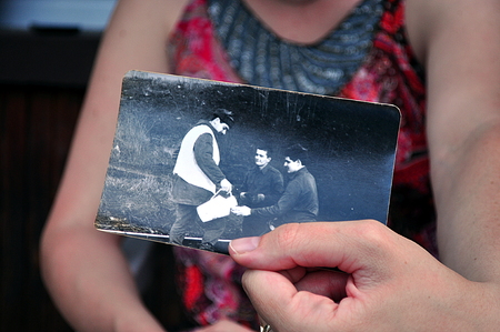 watered: Young woman show the old picture in her hand Stock Photo
