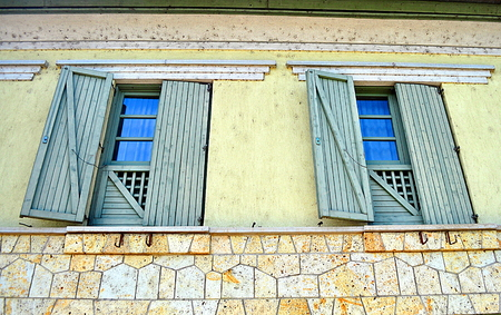 frontage: Great big window with huge wood shutters Stock Photo