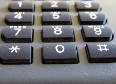 dial pad: Classical Dark Telephone numbers close up macro photo Stock Photo