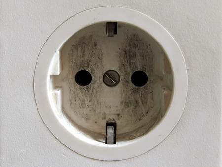 grounded plug: Old used european office white electric connector Stock Photo
