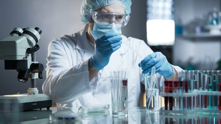 Laboratory worker measuring exact formula for hypoallergenic cosmetic products