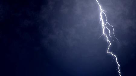 Detailed view of electric firebolt flashing down towards the ground, nature