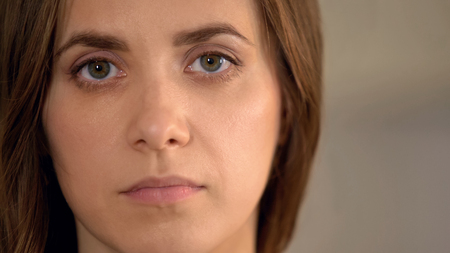 Serious young woman looking at camera, domestic violence victim, face closeup, stock footage