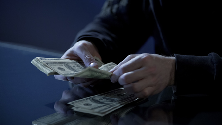 Male hands counting dollars, black salary, money laundering, illegal business, stock footage