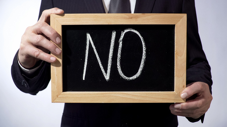 No written on blackboard, businessman holding sign, calling to stop corruption, stock footage