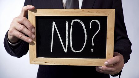 No with question mark written on blackboard, businessman holding sign, concept, stock footage