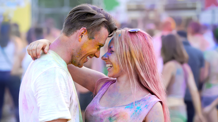 Beautiful girl dancing with handsome man, smiling couple flirting at festival Stock Photo