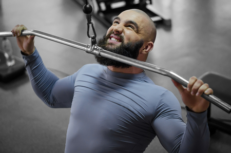 Emotions of professional athlete pulling down heavy weight, sports training Stock Photo
