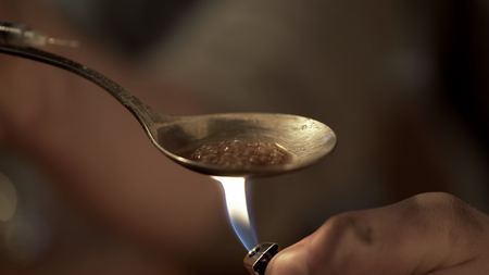 Dangerous liquid narcotic substance prepared in spoon, drug dependence problem Stock Photo