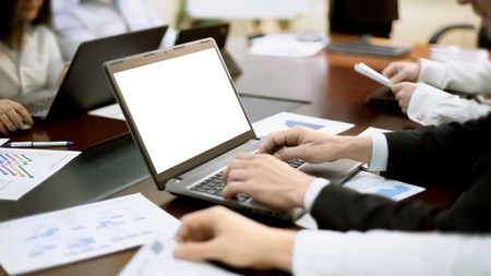 Businessman works on laptop at business meeting, developing strategy, conference