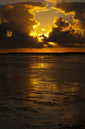 wadden sea: Sunset above the coastal tidal flats of the Frisian Wadden Sea. In the distance the island of Ameland.