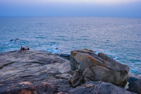 Palolem beach on sunset. Rocky coast in Indian Goa