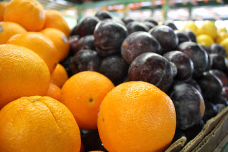 fresh oranges, plums and lemons for sale at local country market