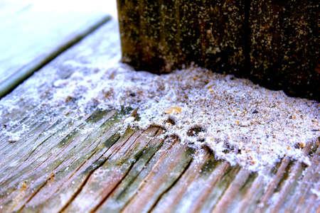 sand on boardwalk after rain closeup