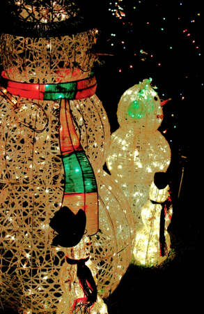 snowman light family outside at night