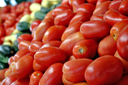 roman tomatoes and vegetables at market unpackaged
