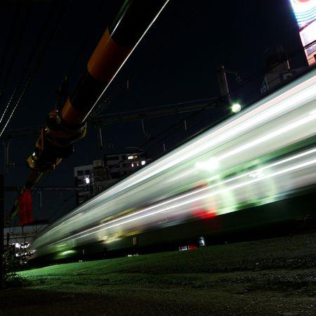 Bullet train running through night Tokyo photo
