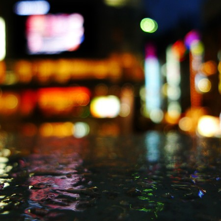 Neon lights in Shinjuku, Tokyo and droplets on a railing. photo