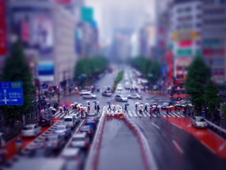 People Walking across the Street on a Rainy Day Stock Photo - 9842000