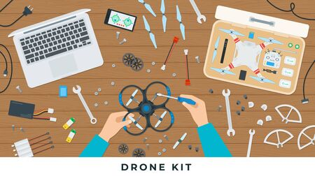 Drone kit. Vector flat illustrations. The hand man working with quadcopter tools on the table.