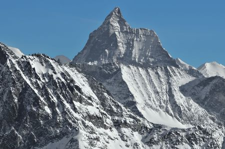 ordeal: The Matterhorn (west face) in the Swiss Alps with the Lion ridge to the right and the famous hornli ridge on the left